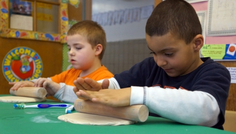 1st graders enjoy their ceramics residency with teaching artists Gaia Starr & Peter Barnett. Photo: Misun Jin.