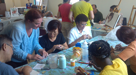 Caption: Seniors create ceramic tiles with artist Jennifer Wade.