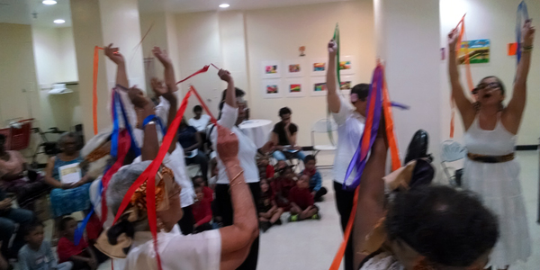 Ribbon dance enhances a creative movement and music call & response performance at Phillip Howard Senior Center with teaching artist Yelimara Concepcion.