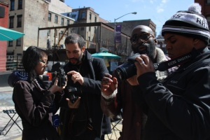 Teaching Artists Sam Barzilay and Russell Frederick of UPI assist students while shooting in DUMBO.