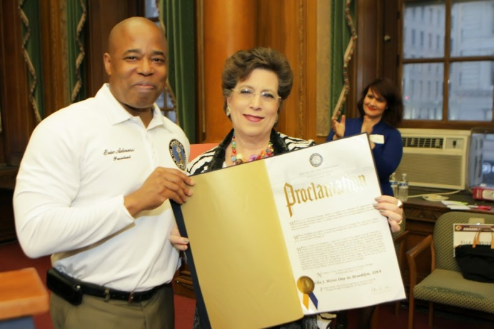BAC Executive Director Ella Weiss receives proclamation from Brooklyn Borough President Eric L. Adams for her dedicated service to the borough. Photo Credit: Marvin Roberts Photography, 2015.