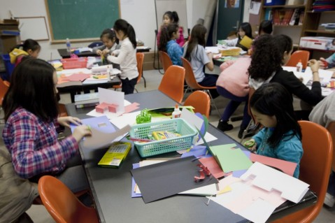 Students create pop up books as a part of Pixy Liao's workshop.