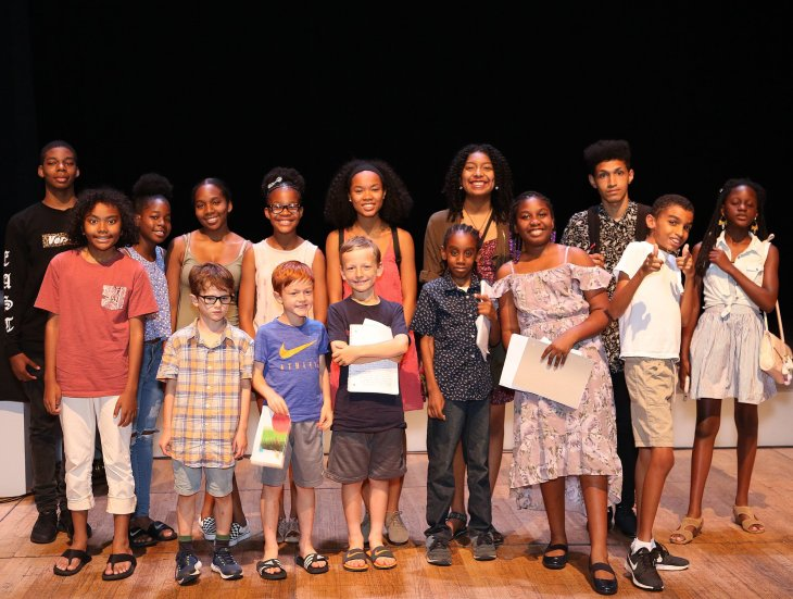 Children on stage with poems